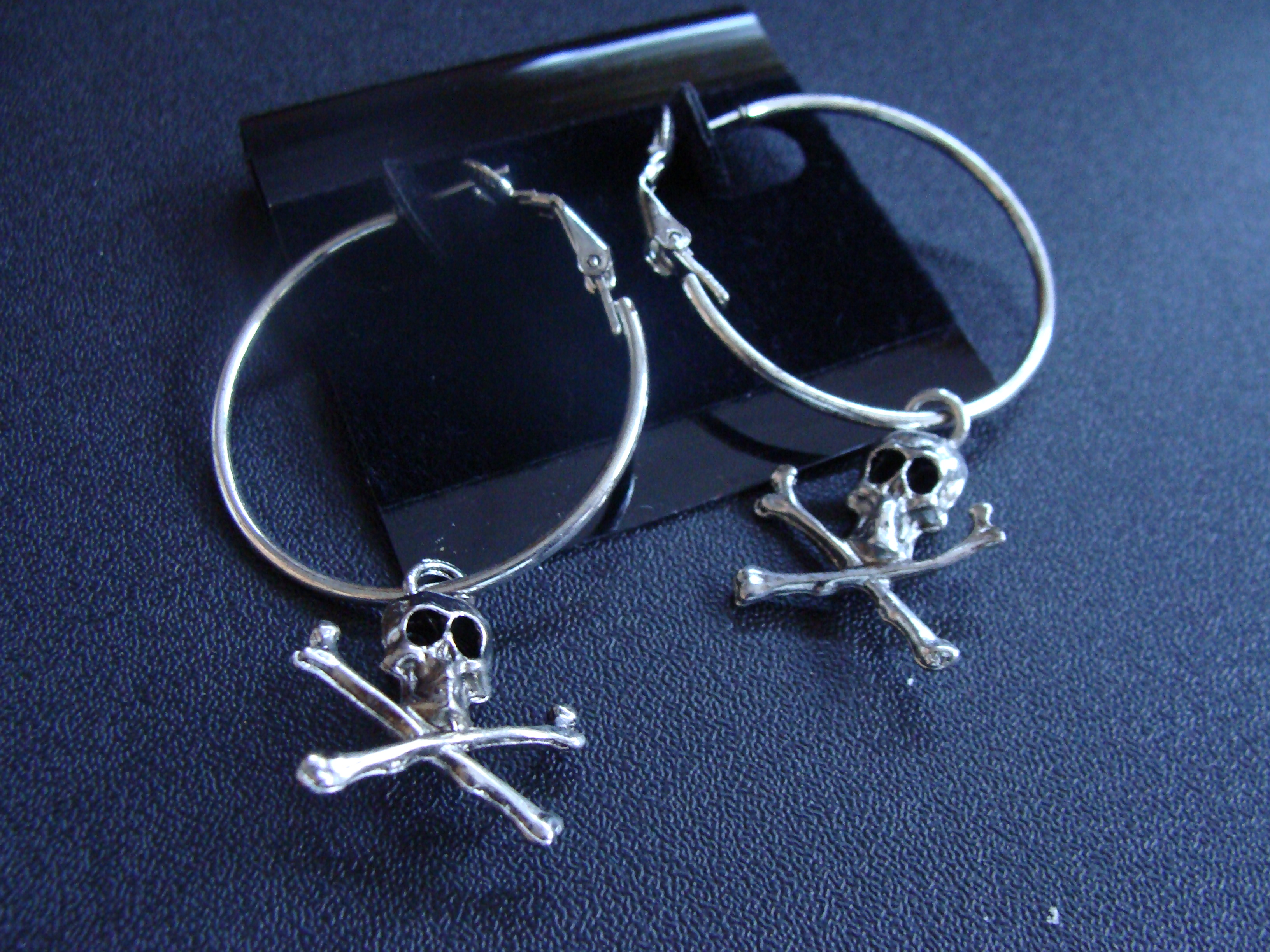 "#3555  7/8""  CRYPTICS TM SKULL & CROSSBONE EARRINGS ON A 1 1/4"" D HOOP BY POLLY PRODUCTS"